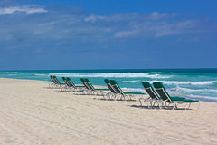 Miami Beach in spring with rolling waves and empty beach chairs. Stock Photo