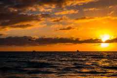 Miami Beach Sunrise. Sunrise on Miami Beach with clouds and ships on horizon Stock Images