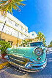Old Buick from 1954 stands as attraction in front of famous Avalon Hotel in Miami Beach. MIAMI BEACH, USA - AUGUST 02: midday view at Ocean drive on August 02 Royalty Free Stock Photo