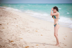 Miami Beauty. Beautiful fit model wearing a thong bikini at the gorgeous blue water beaches of florida on vacation Stock Image