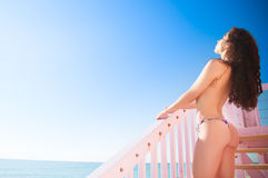 Miami Beauty. Beautiful fit model wearing a thong bikini at the gorgeous blue water beaches of florida on vacation Stock Photos