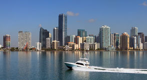 Miami Biscayne Bay Skyline. Wide angle view of Miami's Biscayne Bay skyline along Brickell Avenue from the Rickenbacker Causeway Bridge with a fishing yacht royalty free stock image