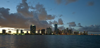 Miami city night skyline. Scenic view of south beach Miami night skyline under cloudscape with sea in foreground, Florida, U.S.A stock image
