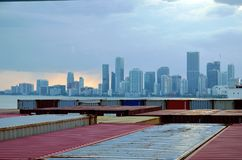 Miami city skyline, view from the container port. Miami city skyline, view from the cargo container ship berthed in the port of Miami royalty free stock image