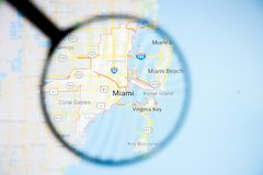 Miami city visualization illustrative concept on display screen through magnifying glass. Miami city visualization illustrative concept on screen through stock image
