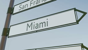 Miami direction sign on road signpost with American cities captions. Conceptual 3D rendering Royalty Free Stock Photography