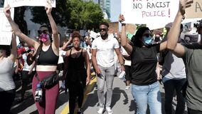 Miami Downtown, FL, USA - MAY 31, 2020: Silence is violence. Black Lives Matter. Many american people went to peaceful