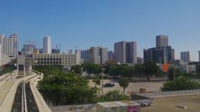 Miami downtown metro train ride high across buildings 4k florida usa stock footage