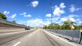 MIAMI, FL - APRIL 2018: Traffic along I-95 interstate. THis is a. Major road that crosses US Stock Images