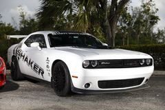 Image of a Dodge Challenger white with racing stickers Stock Image