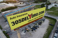 Auto insurance billboard advertisement. MIAMI, FL, USA - JULY 15, 2017: Aerial image of an auto insurance billboard advertisement in Miami Stock Image