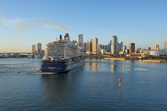 Cruise ship entering Port of Miami. Miami, Florida 11-10-2018 Cruise ship in the Port of Miami turning basin with the Miami skyline in the background on a calm stock photography