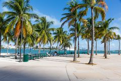 Miami bayfront park. MIAMI, FLORIDA - 18 JANUARY 2017: People sitting on a bench in Bayfront park Royalty Free Stock Photo