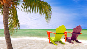 Miami Florida, Panorama of colorful lounge chairs. Panorama of colorful lounge chairs at a tropical paradise beach in Miami Florida. Beautiful aqua green waters Stock Image