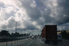 Miami Florida rainy driving road with trucks Royalty Free Stock Photos