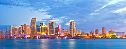 Miami Florida at sunset. Cityscape of modern downtown buildings illuminated with reflections in the waters of Biscayne BAy Royalty Free Stock Image