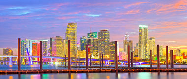 Miami Florida at sunset, colorful skyline. Of illuminated buildings and docks Royalty Free Stock Photography