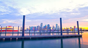 Miami Florida at sunset, colorful skyline. Of illuminated buildings and docks Stock Photo