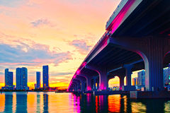 Miami Florida at sunset, colorful skyline. Of illuminated buildings and Macarthur causeway bridge Royalty Free Stock Photography