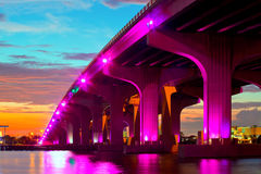 Miami Florida at sunset, colorful skyline. Of illuminated buildings and Macarthur causeway bridge Stock Image