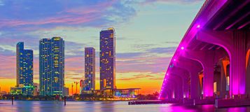 Miami Florida at sunset, colorful skyline. Of illuminated buildings and Macarthur causeway bridge Royalty Free Stock Images