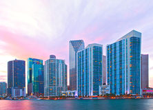 Miami Florida, sunset skyline. Miami Florida, sunset city skyline. Cityscape of residential and business buildings illuminated at sunset with reflection Stock Photo