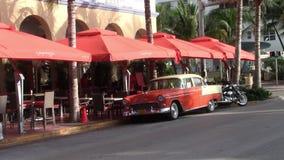 Orange oldtimer on Ocean Drive in Miami Beach, Florida. Miami, Florida, USA - Circa July 2013: Orange Oldtimer Car on Ocean Drive in Miami Beach, Florida, United stock video