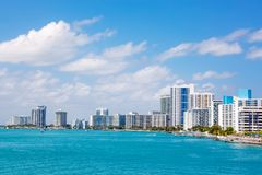 Miami, Florida, USA downtown skyline. Building, ocean beach and blue sky. Beautiful city of United States of America.  stock photo
