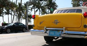 Yellow Antique 1955 Oldsmobile In Miami Beach. Miami, Florida / USA, February 24, 2019: Yellow Antique 1955 Oldsmobile Super 88 Convertible Parked On Ocean Drive stock video