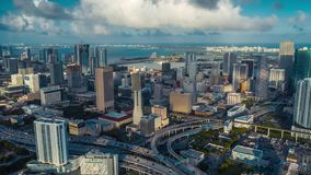 MIAMI, FLORIDA, USA - JANUARY 2019: Aerial drone panorama view flight over Miami downtown. Tall buildings from above.