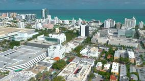 MIAMI, FLORIDA, USA - JANUARY 2019: Aerial drone panorama view flight over Miami beach city centre. Streets, hotels and residential buildings from above stock footage