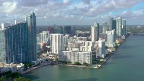 MIAMI, FLORIDA, USA - JANUARY 2019: Aerial drone view flight over Miami Edgewater district on Biscayne Bay. MIAMI, FLORIDA, USA - JANUARY 2019: Aerial drone stock video footage