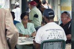 Elderly playing domino at the Domino park in Little Havana district in Miami, Florida Stock Photo