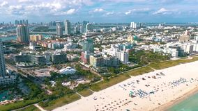MIAMI, FLORIDA, USA - MAY 2019: Aerial drone panorama view flight over Miami beach. South Beach sand and sea from above. MIAMI, FLORIDA, USA - MAY 2019: Aerial stock footage