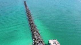 Miami, Florida, Usa - May 2019: Aerial drone panorama view flight over Miami beach. Breakwater pier and sea from above. Miami, Florida, Usa - May 2019: Aerial stock video