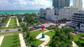 Miami, Florida, Usa - May 2019: Aerial drone panorama view flight over Miami beach city centre. Collins park from above. Miami, Florida, Usa - May 2019: Aerial stock footage