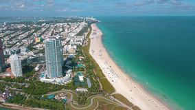 MIAMI, FLORIDA, USA - MAY 2019: Aerial drone panorama view flight over Miami beach. South Beach sand and sea from above. MIAMI, FLORIDA, USA - MAY 2019: Aerial stock video