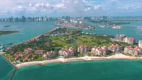 Miami, Florida, Usa - May 2019: Aerial drone view flight over Miami beach. South Beach and Fisher island from above. Miami, Florida, Usa - May 2019: Aerial stock video