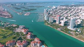 MIAMI, FLORIDA, USA - MAY 2019: Aerial drone view flight over Miami beach. South Beach and Fisher island from above. MIAMI, FLORIDA, USA - MAY 2019: Aerial stock video footage