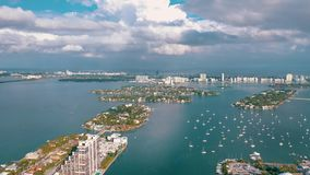 MIAMI, FLORIDA, USA - MAY 2019: Aerial drone view flight over Miami Biscayne Bay. Boats and yachts from above. MIAMI, FLORIDA, USA - MAY 2019: Aerial drone view stock video