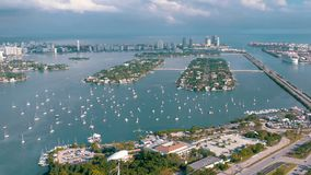 MIAMI, FLORIDA, USA - MAY 2019: Aerial drone view flight over Miami Biscayne Bay. Boats and yachts from above.
