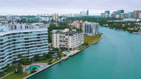 MIAMI, FLORIDA, USA - MAY 2019: Aerial drone view flight over Miami Biscayne Bay and Indian Creek island. Luxury houses.