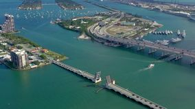 MIAMI, FLORIDA, USA - MAY 2019: Aerial drone view flight over Miami Biscayne Bay. Overpasses and viaducts from above. MIAMI, FLORIDA, USA - MAY 2019: Aerial stock footage