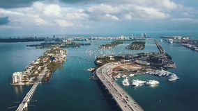 MIAMI, FLORIDA, USA - MAY 2019: Aerial drone view flight over Miami Biscayne Bay. Overpasses and viaducts from above. MIAMI, FLORIDA, USA - MAY 2019: Aerial stock video footage