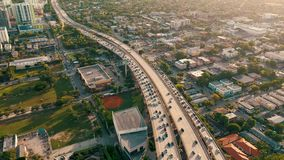 MIAMI, FLORIDA, USA - MAY 2019: Aerial drone view flight over Miami downtown. Road viaduct and overpass from above.