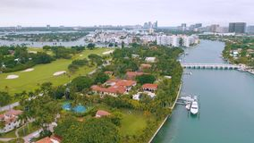MIAMI, FLORIDA, USA - MAY 2019: Aerial drone view flight over Miami Biscayne Bay and Indian Creek island. Luxury houses. MIAMI, FLORIDA, USA - MAY 2019: Aerial stock footage