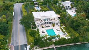 Miami, Florida, Usa - May 2019: Aerial drone view flight over Miami Biscayne Bay and Indian Creek island. Luxury houses. Miami, Florida, Usa - May 2019: Aerial stock video