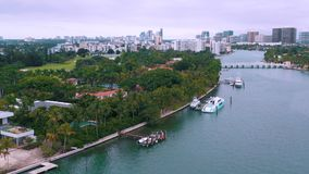 Miami, Florida, Usa - May 2019: Aerial drone view flight over Miami Biscayne Bay and Indian Creek island. Luxury houses. Miami, Florida, Usa - May 2019: Aerial stock video footage