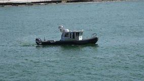 MIAMI,FLORIDA,USA-MAY 2016.Miami Dade Police boat patrolling the Miami Port area,4K. stock video footage