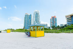 Miami high rise behind colorful little yellow and blue beach kio Royalty Free Stock Images